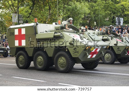 Military armoured ambulance (some blur) - stock photo