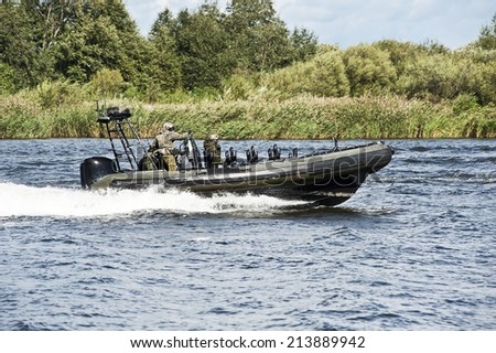 military boats patrolling - stock photo