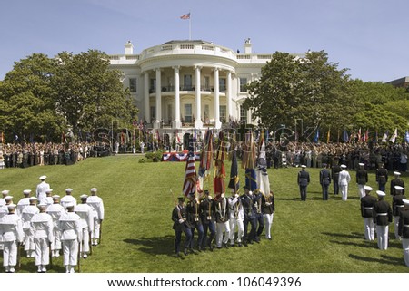 Military branches displaying flag colors on the South Lawn of the White House May 7, 2007 Official State Welcoming of Her Majesty Queen Elizabeth II and Prince Philip to Washington, DC and America