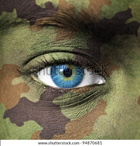 Military colors on human face - stock photo