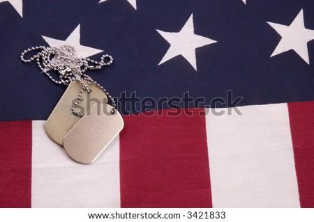 Military Dog Tags on American Flag - stock photo