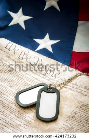 Military dog tags, US constitution and the American flag