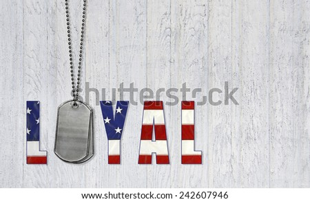 military dog tags with loyal flag font on weathered wood background - stock photo