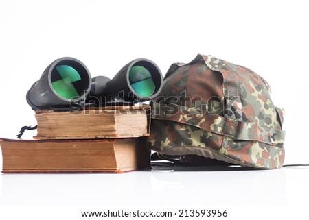 military equipment with helmet,binoculars and  books - stock photo