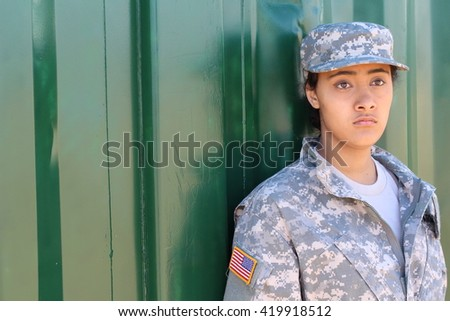 Military ethnic army woman with copy space on the left - stock photo
