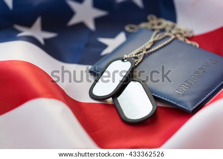 military forces, patriotism, recruitment and national service concept - close up of american flag, passport and military badge - stock photo