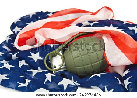 Military hand grenade on American flag - stock photo