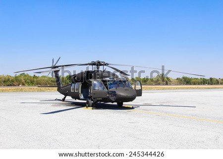 Military helicopter blackhawk at a base - stock photo