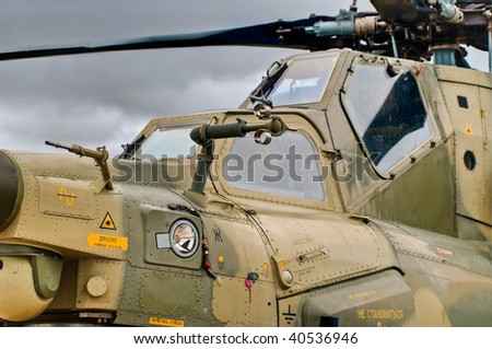 military helicopter cockpit details with sky in background - stock photo