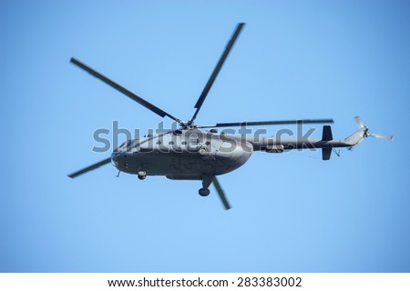 Military helicopter landing. - stock photo