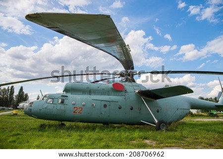military helicopter on a green grass - stock photo