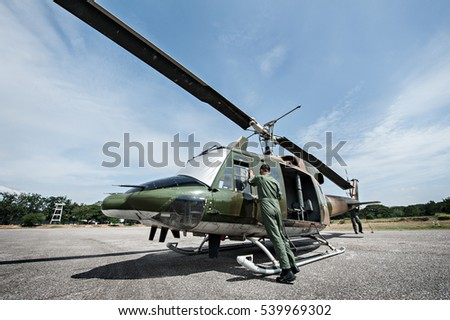 Military helicopter parking at the hangar while engineer doing maintenance after finish the mission