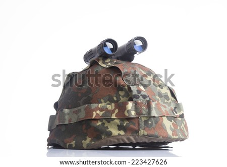 Military helmet and binoculars isolated on a white background - stock photo