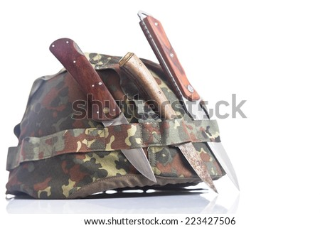 Military helmet and knives - stock photo