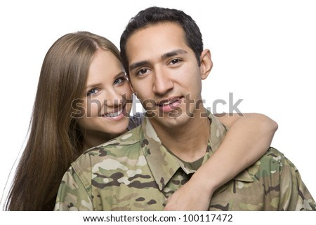 Military Husband and Wife hugging - stock photo