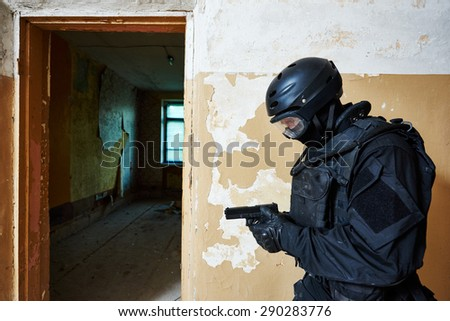 Military industry. Special forces or anti-terrorist police soldier,  private military contractor armed with pistol during clean-up operation, mission - stock photo