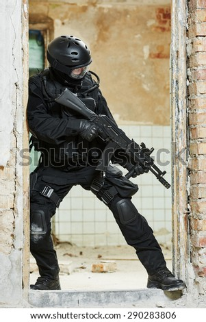 Military industry. Special forces or anti-terrorist police soldier,  private military contractor armed with weapon during clean-up operation, mission - stock photo