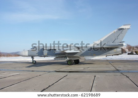 Military jet bomber airplane Su-24 Fencer on take off and landing