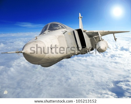 Military jet bomber Su-24 Fencer flying above the clouds. - stock photo