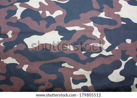 Military khaki camouflage pattern on fabric as a background - stock photo