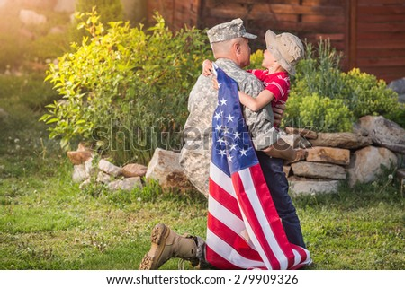 Military man father hugs son. Portrait of happy american family. sunshine - stock photo