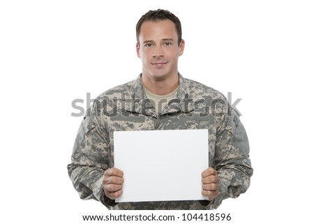 Military Man holding blank sign - stock photo