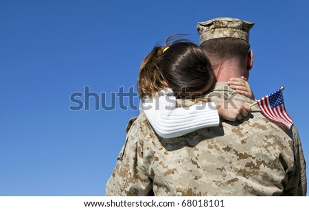 Military Man Hugs Daughter - stock photo