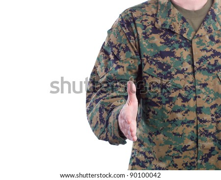 Military Man in Green Fatigues Offers Handshake - stock photo