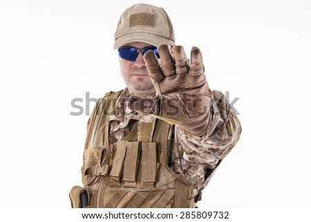 Military man showing stop gesture - stock photo