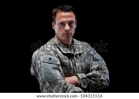 Military man with his arms crossed - stock photo
