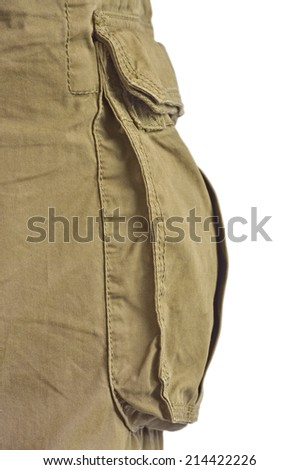 Military olive green army style cotton twill cargo pants storage pocket isolated macro closeup, large detailed camouflage trousers studio shot - stock photo
