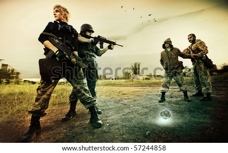 Military patrol in Chernobyl (man and blond woman) is stopping two stalkers on the road - stock photo