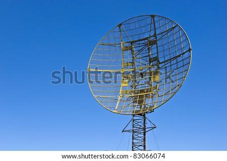 Military radar station against the clear blue sky - stock photo