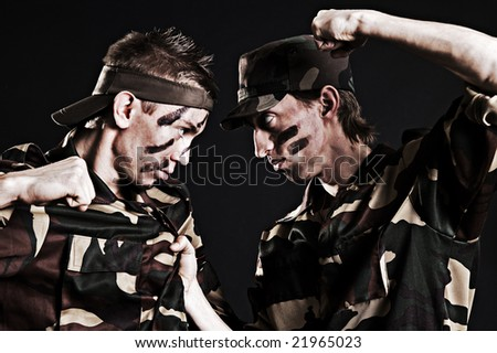 military rivals over black background