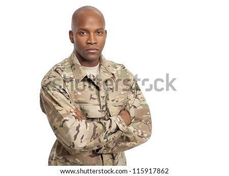 Military serviceman with his arms crossed - stock photo