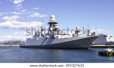military ship in a harbour in italy
