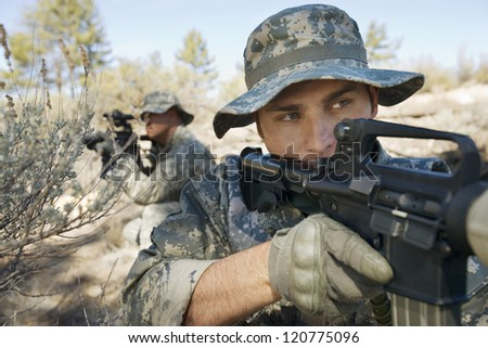 Military solders ready to shoot