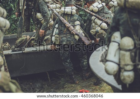 Military, special forces carrying guns used backpacks, travel by river boat , soldier on the boat in the river , image of Navy Seals unit working in sea