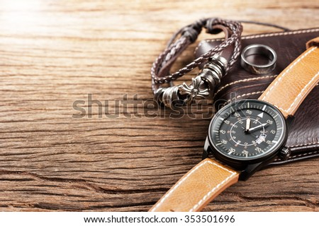 military style watch with brown leather strap