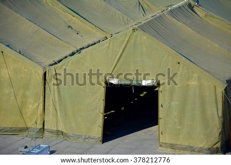 Military tent in the field - stock photo
