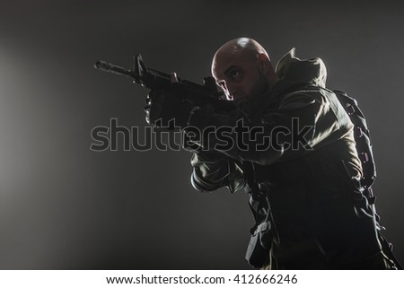 Military, war, conflict, soldiers - Special forces soldier man hold Machine gun on a  dark background, silhouette . Soldier takes aim.  Military equipment of Russian soldiers - stock photo