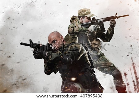 Military, war, conflict, soldiers - Two Special forces soldiers men take aim on machine gun - stock photo