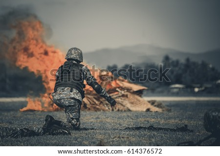 Military war  ,  Military squad crossing the river under fire