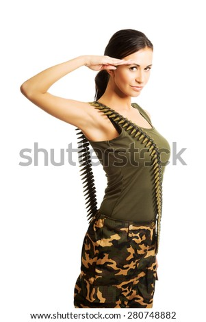 Military woman wearing bullet belt making salute gesture. - stock photo