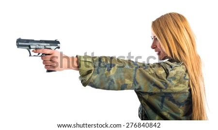 Military woman with gun - stock photo