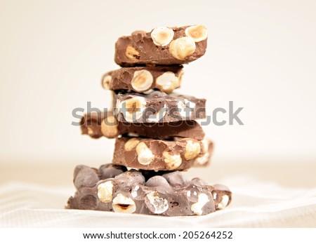 milk and dark chocolate tower background shallow dof  - stock photo