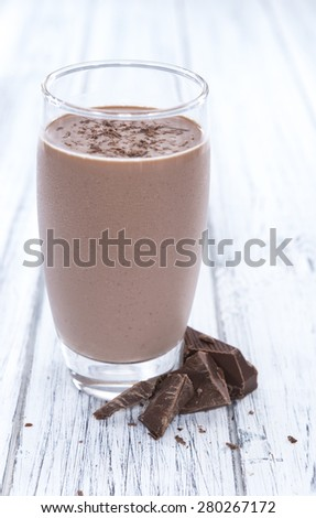 Milk Beverage (Chocolate taste) on a rustic wooden table - stock photo