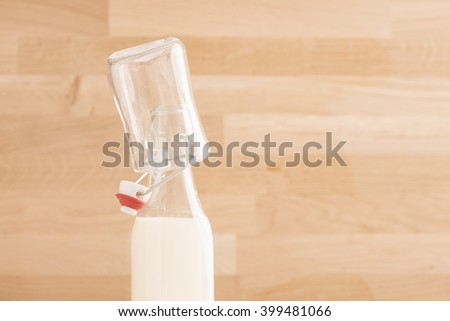 Milk bottle and glass. Concept of healthy food and drink. - stock photo