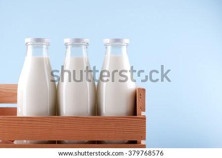 milk bottle in the box - stock photo