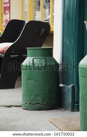 Milk canisters near the door of a restaurant, Killarney, County Kerry, Republic of Ireland - stock photo